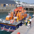 Pic by Tony Rive 25-04-11An injured man is carried off the St Peter Port Lifeboat by Lifeboat Crew and Ambulance and Rescue personnel.