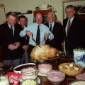Harbourmasters and lifeboat coxswain Peter Bisson make sure that photographer Brian Green carves the turkey for Georgina Keene's christmas party - 1991