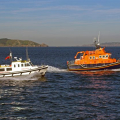 Pic by Tony Rive 16-06-08The St Peter Port relief Lifeboat Roger and Joy Freeman (R) and the Marina Ambulance Flying Christine III on manouvers off St Peter Port after the RNLI's AGM at the Guernsey Yacht Club.