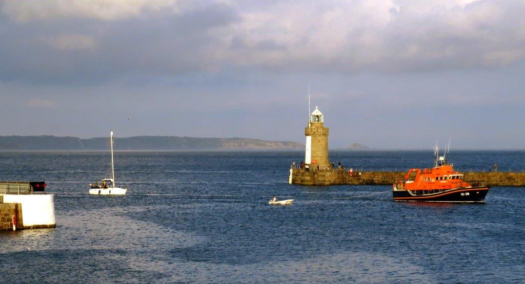 Daniel L Gibson with yacht Jeanie 3 and Maina Dory in St Peter Port harbour's Pierheads 29-06-14 Pic by Tony Rive.jpg