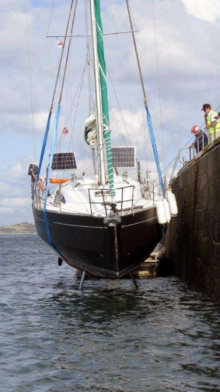 French yacht Douze (13) being craned out of St Peter Port harbour 22-08-14 Pic by Tony Rive (1).jpg