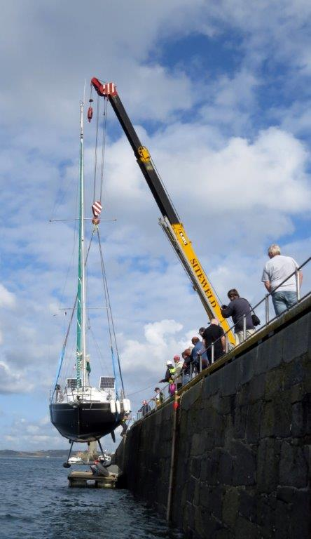 French yacht Douze (15) being craned out of St Peter Port harbour 22-08-14 Pic by Tony Rive (1).jpg