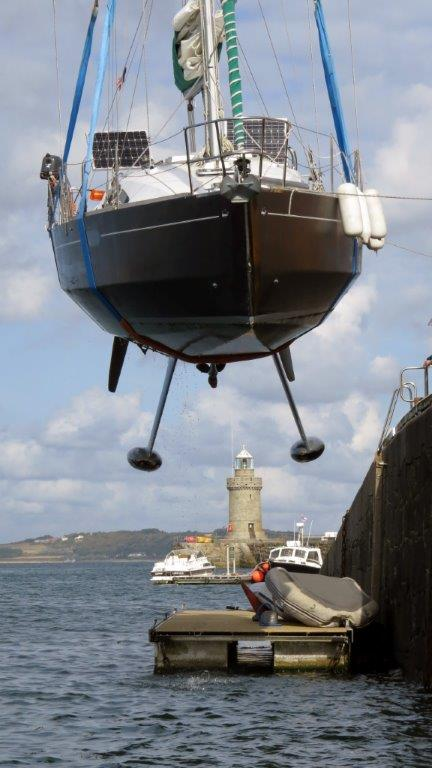 French yacht Douze (17) being craned out of St Peter Port harbour 22-08-14 Pic by Tony Rive (1).jpg