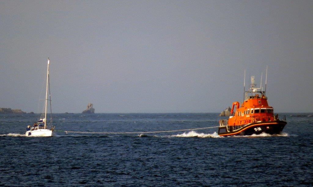 Lifeboat Daniel L Gibson towing the British yacht Jeanie 3 twards St Peter Port Harbour 29-06-14 Pic by Tony Rive (1).jpg
