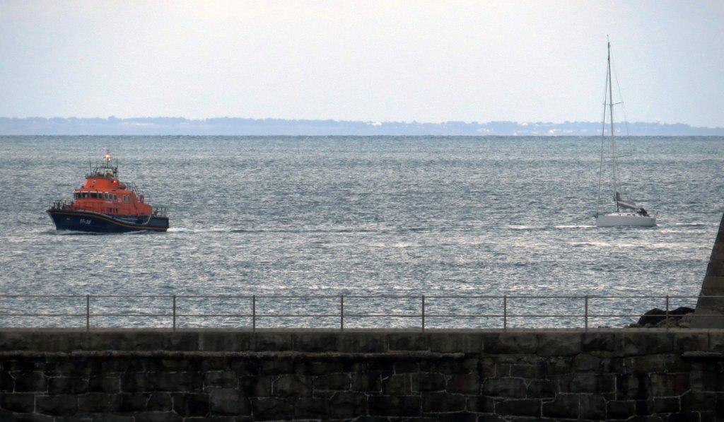 Relief Lifeboat Daniel L Gibson towing the local yacht Majic back to St Peter Port 16-08-14 Pic by Tony Rive (1).jpg