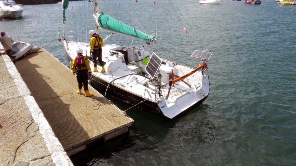 Seawater being pumped from the hull of the French yacht Douze (12) in St Peter Port 22-08-14 Pic by Tony Rive.jpg