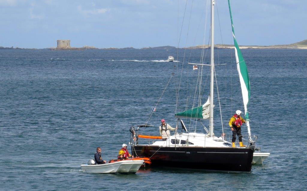 The Lifeboat Y boat moning the French yacht Douze (13) to the Old Lifeboat slip 22-08-14 Pic by Tony Rive (1).jpg