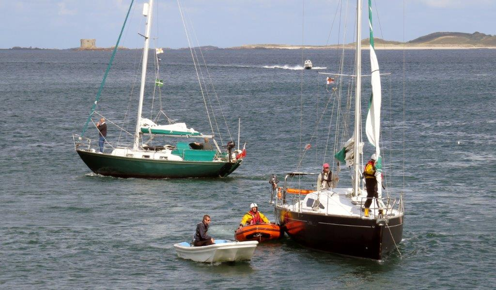The Lifeboat Y boat moning the French yacht Douze (14) to the Old Lifeboat slip 22-08-14 Pic by Tony Rive (1).jpg
