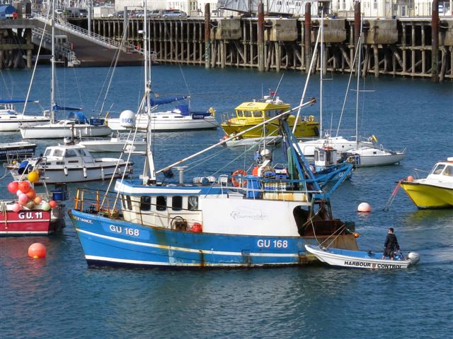 Pic by Tony Rive 17-09-15 Marina Staff towing the local Fishing boat Defiance to its berth alongside the Fish Quay after it had been towed into St Peter Port by lifeboat Spirit of Guernsey.