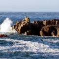 The inshore rescue boat next to the rocks - photo by Tony Rive