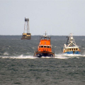 Pic by Tony Rive 17-09-15Guernsey's Lifeboat Spirit of Guernsey towing the local Fishing boat Defiance south down the Little Russel south of Roustel Beacon heading for St Peter Port harbour. The 40ft Aqua-Star Trawler built in Ireland got a Rope wrapped around its Propellor as it steamed north towards the Casquete's Fishing Grounds