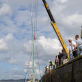 French yacht Douze (12) being craned out of St Peter Port harbour 22-08-14 Pic by Tony Rive (1).jpg