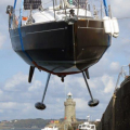 French yacht Douze (16) being craned out of St Peter Port harbour 22-08-14 Pic by Tony Rive (1).jpg