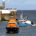 Pic by Tony Rive 17-09-15 One of two Marina Dories pull up alongside the 40ft local Fishing boat Defiance in St Peter Port after the St Peter Port Lifeboat Spirit of Guernsey towed it into Port, before towing it to it's berth alongside the Eastside of the Fish Quay.
