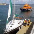 Lifeboat Daniel L Gibson stands by the French yacht Douze (12) in St Peter Port harbour 22-08-14 Pic by Tony Rive.jpg