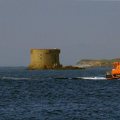 Lifeboat Daniel L Gibson towing the British yacht Jeanie 3 twards St Peter Port Harbour 29-06-14 Pic by Tony Rive (2).jpg