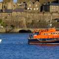 Lifeboat Daniel L Gibson with Yacht Jeanie 3 in St Peter Port harbour 29-06-14 Pic by Tony Rive.jpg
