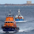 Pic by Tony Rive 17-09-15Guernsey's Lifeboat Spirit of Guernsey towing the local Fishing boat Defiance south down the Little Russel heading for St Peter Port harbour. The 40ft Aqua-Star Trawler built in Ireland got a Rope wrapped around its Propellor as it steamed north towards the Casquete's Fishing Grounds