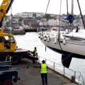 The French yacht Waton being lifed out of St Peter Port harbour 15-05-15 Pic by Tony Rive.jpg