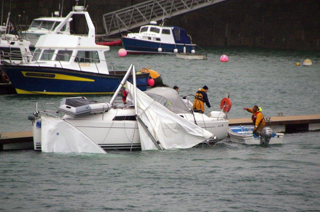The Guernsey Lifeboat towing the French Dis-masted yacht Tiekoroba into St Peter Port 28-04-12 Pic by Tony Rive (8)