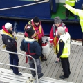 Anita Bomba's French crew being met by the Harbour Master Peter Gill 07-02-10 Pic by Tony Rive (2)