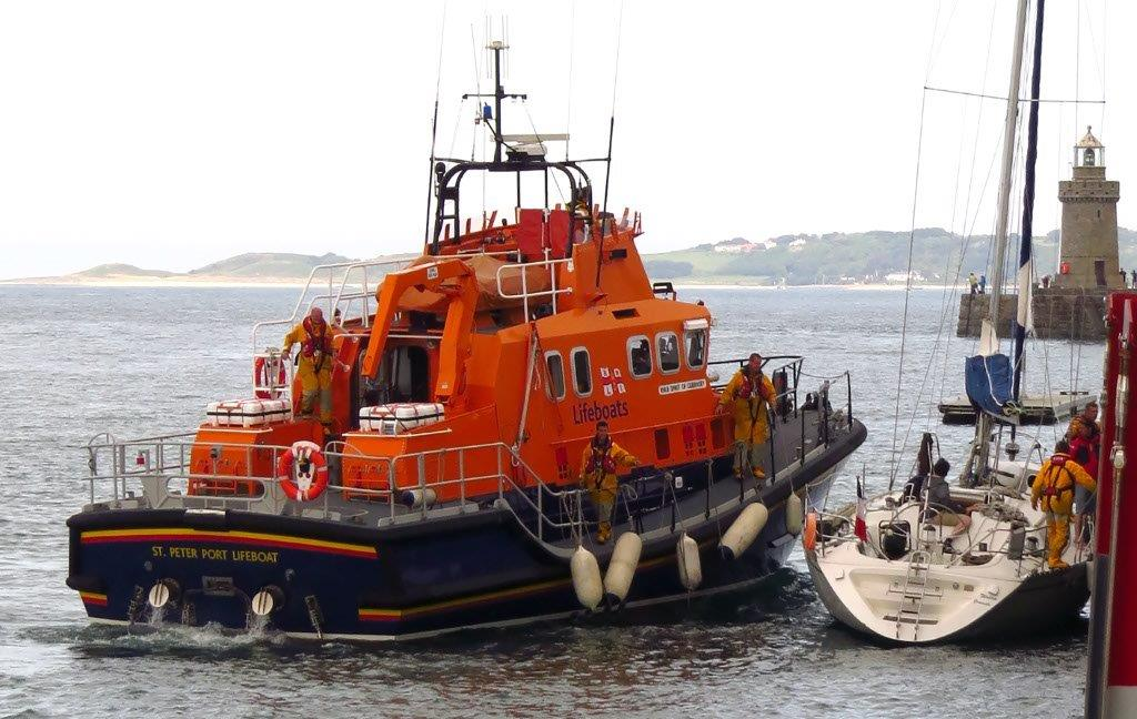Spirit of Guernsey picking up two crew and a salvage pump from french yacht Waton 15-05-15 Pic by Tony Rive