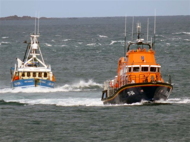 Pic by Tony Rive 17-09-15 Guernsey's Lifeboat Spirit of Guernsey towing the local Fishing boat Defiance south down the Little Russel heading for St Peter Port harbour. The 40ft Aqua-Star Trawler built in Ireland got a Rope wrapped around its Propellor as it steamed north towards the Casquete's Fishing Grounds