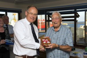 Pic by Tony Rive 20-07-16 Guernsey's Bailiff Sir Richard Collas presenting Guernsey' Top Lifeboat (Top Box) Fundraiser Alf Solway a Plaque from the RNLI and Guernsey's Lifeboat Station after year of him raising funds for our local Station totalling £31,500. Alf raises Donation's aiding people with various Aches and Pains but never charges for his services, only asking for donation's to Guernsey Lifeboat Station.