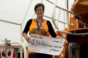 great-north-run-competitor-julie-eastwood-with-her-cheque-of-1000-for-the-guernsey-branch-of-the-rnli-28-10-16-pic-by-tony-rive